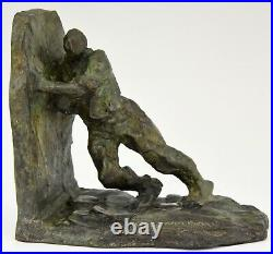 Art Deco French bronze bookends two men pushing Victor Demanet 1925