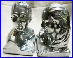 Art Deco bookends of Lovers in polished aluminum 5-1/4 tall a pair USA