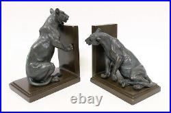 Gorgeous pair of bronze lioness art deco book ends on bronze bases